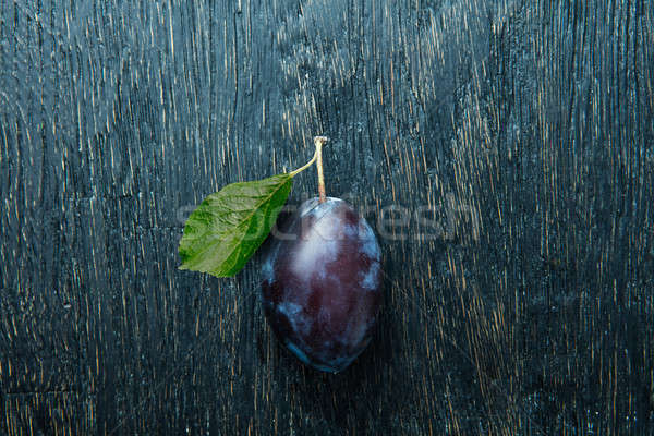 One ripe tasty beautiful seasoning fruit berry of purple plum Stock photo © artjazz