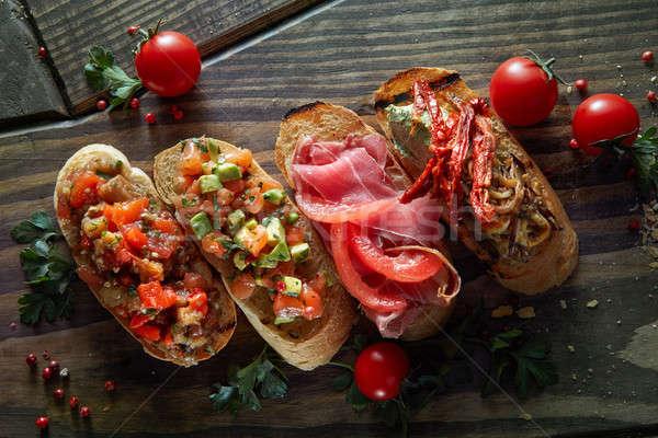 Italian crostini with various toppings Stock photo © artjazz
