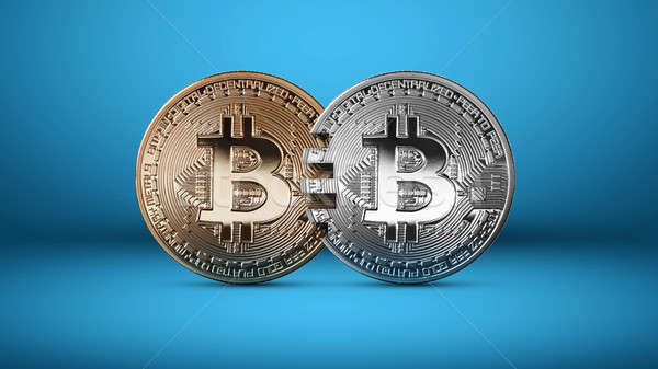 Stock photo: Silver and gold bitcoin coins on a blue background money transfer concept.