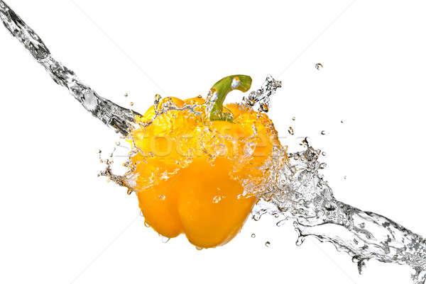 água doce salpico amarelo doce pimenta isolado Foto stock © artjazz