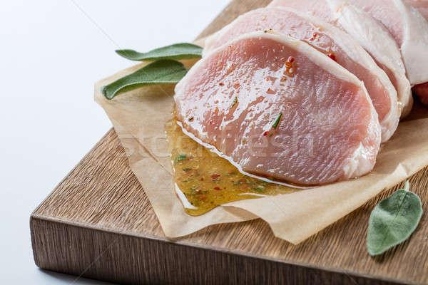 Surowy wieprzowina miodu zioła mięsa zielone Zdjęcia stock © artjazz