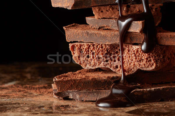 Rotto pezzi cioccolato sciroppo di cioccolato Foto d'archivio © artjazz