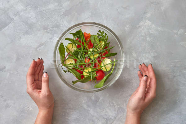 Fresh salad from raw vegetables Stock photo © artjazz