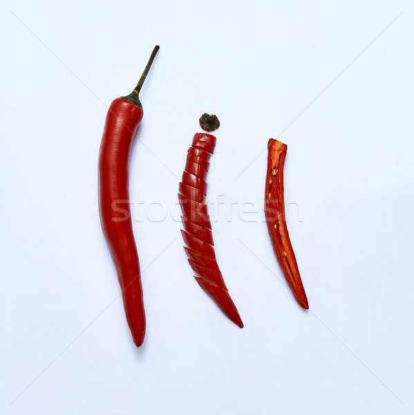 sliced red chili or chilli cayenne pepper on a gray background, top view Stock photo © artjazz