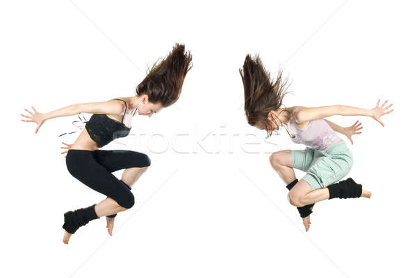 jumping young dancers isolated on white background Stock photo © artjazz