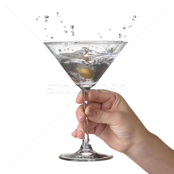 Martini with splash and olive in womans hand isolated on white Stock photo © artjazz