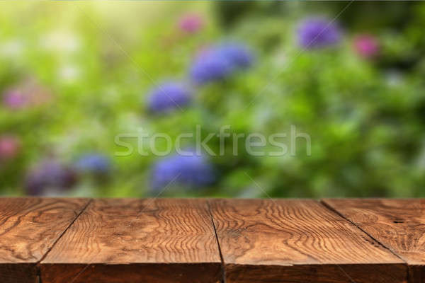 wooden table and color hydrangea flowers on backgound Stock photo © artjazz
