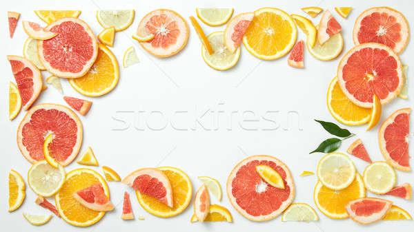 Citrus gyümölcs keret szeletek izolált fehér citrus Stock fotó © artjazz