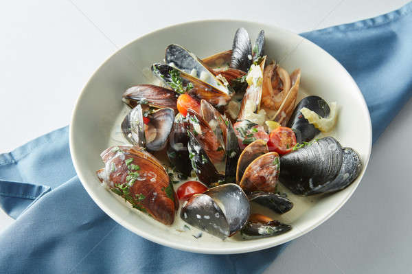 Serving of fresh cooked blue mussels in plate Stock photo © artjazz