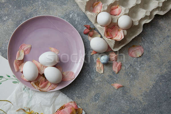 chicken eggs on a plate Stock photo © artjazz