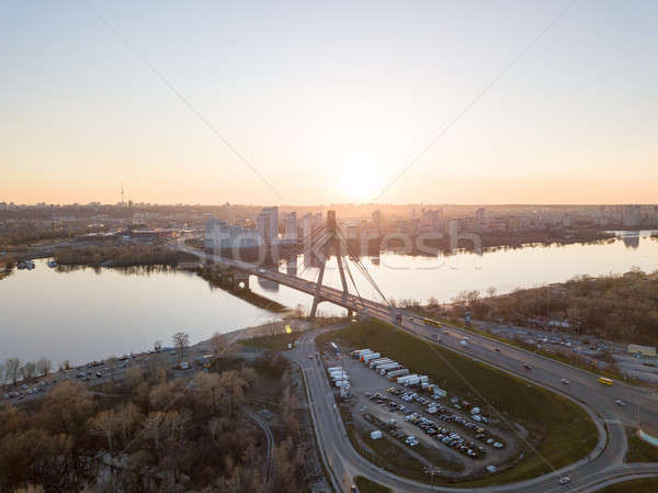 North Bridge with a large parking for cars over the Dnieper River and a view of the Skaimol shopping Stock photo © artjazz