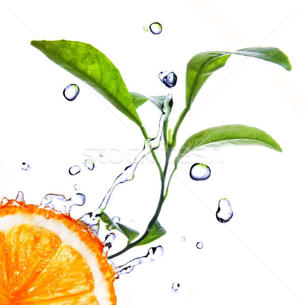 water drops on orange with green leaves isolated on white Stock photo © artjazz