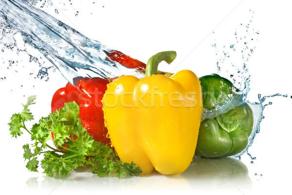 red, yellow, green pepper and parsley with water splash isolated Stock photo © artjazz