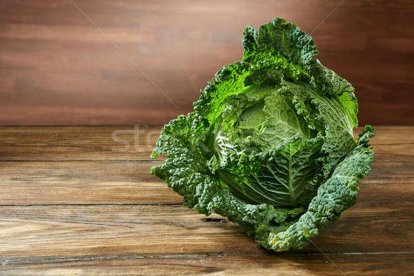 Single head of Savoy cabbage Stock photo © artjazz