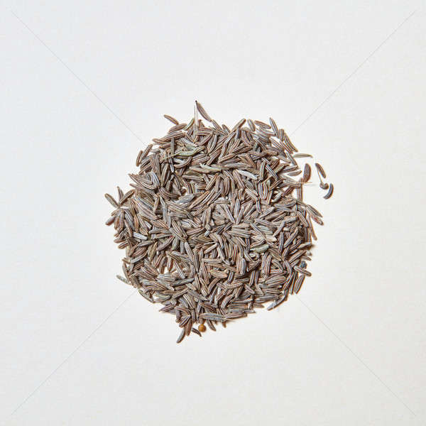 A round pattern of natural herb cumin seeds isolated on white background Stock photo © artjazz
