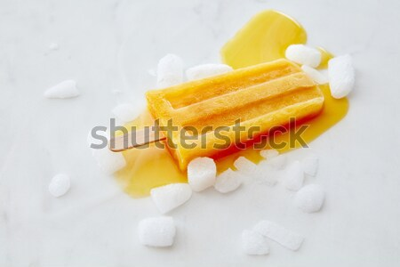 Melting peach ice cream on a stick. A pattern of splashes and pi Stock photo © artjazz