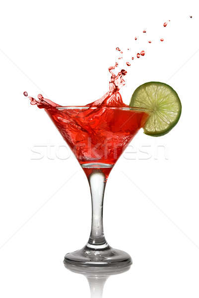 Red cocktail with splash and lime isolated on white Stock photo © artjazz