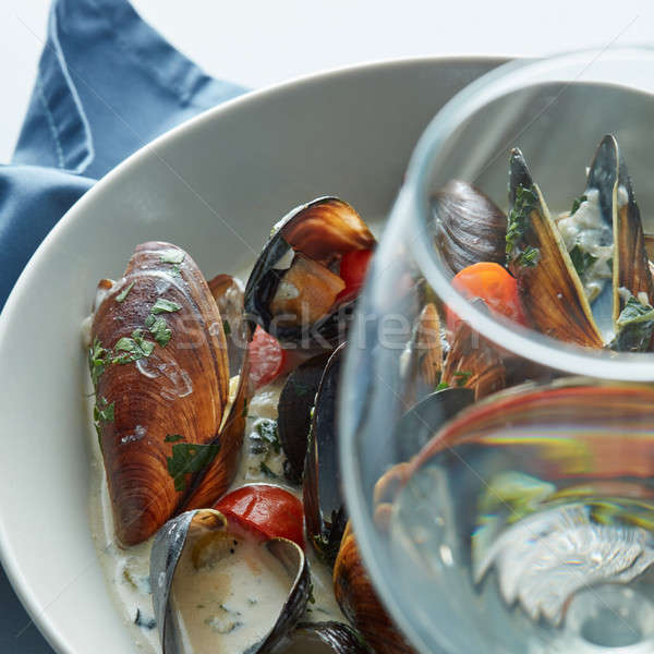 Delicious mussels with sauce Stock photo © artjazz