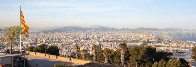 Aerial view of Barcelona city with flag Stock photo © artjazz