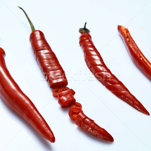 Sliced fresh red chillies isolated on white Stock photo © artjazz