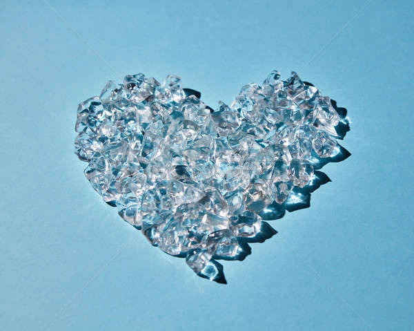 Heart made of ice cubes on a blue background Stock photo © artjazz