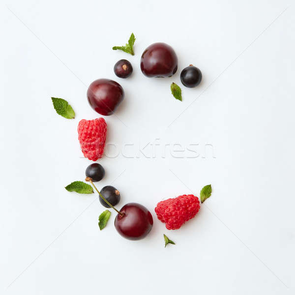 Fresh picked berry pattern of letter C english alphabet from natural ripe berries - black currant, c Stock photo © artjazz
