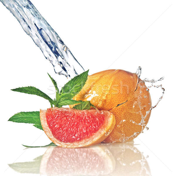 Water splash on grapefruit with mint isolated on white  Stock photo © artjazz