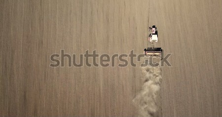 harvester in a field creating an abstract background texture, top view Stock photo © artjazz