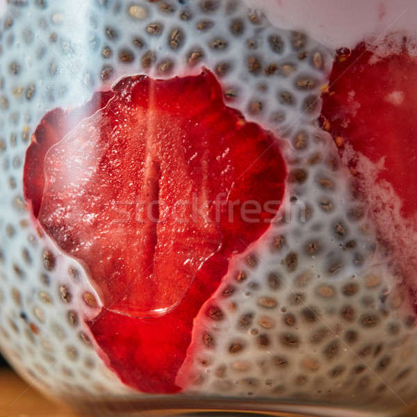 Dessert breakfast layered chia seeds pudding with strawberrie close up Stock photo © artjazz