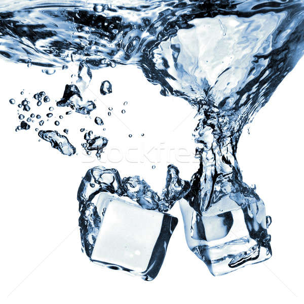 Stock photo: ice cubes dropped into water with splash isolated on white