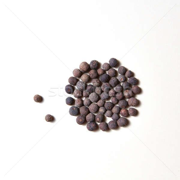 Whole aromatic allspice roung pattern isolated on white background. Stock photo © artjazz