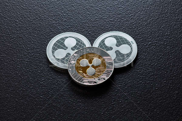 Coins of crypto currency ripple isolated on a dark background. Business and technology concept. Top  Stock photo © artjazz
