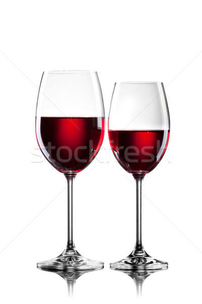 Stock photo: Red wine in glasses isolated on white
