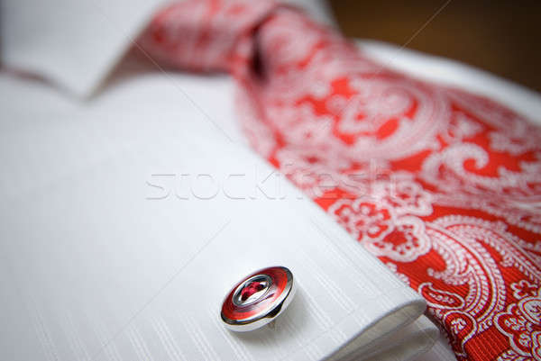 close-up photo of stud on white shirt with red tie Stock photo © artjazz