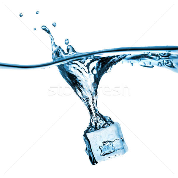 ice cube dropped into water with splash isolated on white Stock photo © artjazz