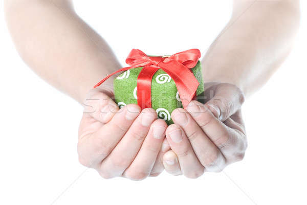 Hands holding gift isolated on white Stock photo © artjazz