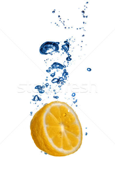 Fresh orange dropped into water with bubbles isolated on white Stock photo © artjazz