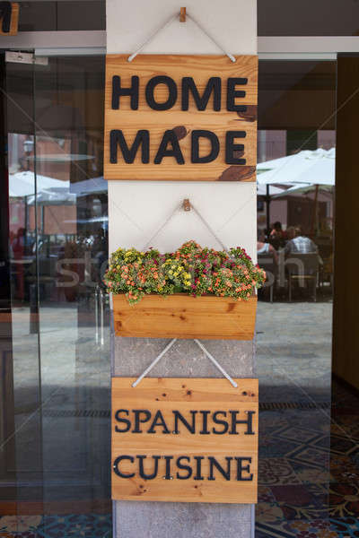 Home made spanish cuisine sign on restaurant door Stock photo © artjazz