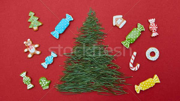 Karácsonyi üdvözlet fenyőfa tűk sütik karácsony absztrakt Stock fotó © artjazz