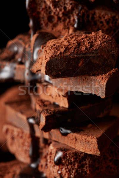Rotto pezzi cioccolato sciroppo di cioccolato cioccolato fondente Foto d'archivio © artjazz