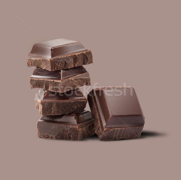 pieces of chocolate on a brown background Stock photo © artjazz