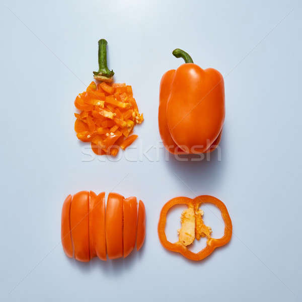 Crispy delicious yellow bell peppers in the form of different cuts on a gray background Stock photo © artjazz