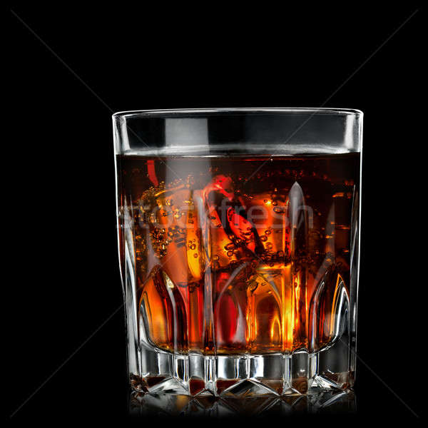 cola with cognac in glass on black Stock photo © artjazz