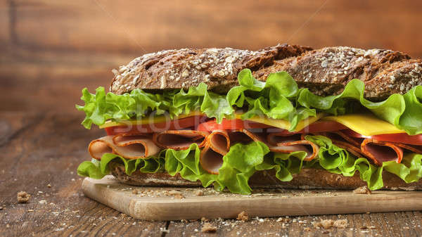 Stock photo: Sandwich on the wooden table