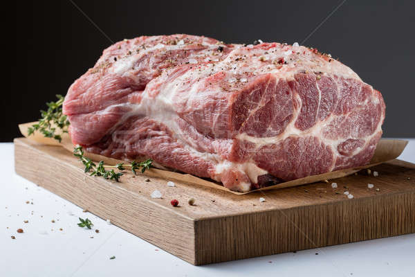 Photo of raw meat. Pork neck with herbs Stock photo © artjazz