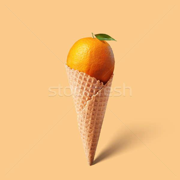 Waffle cornet with orange Stock photo © artjazz