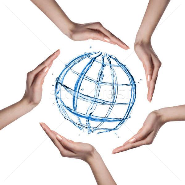 Stockfoto: Wereldbol · water · spatten · menselijke · handen · geïsoleerd