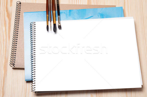 Notebooks and brushes Stock photo © Artspace
