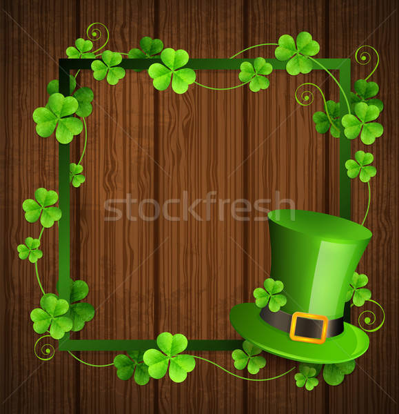 Сlover leaves and green hat on a wooden background. Stock photo © Artspace
