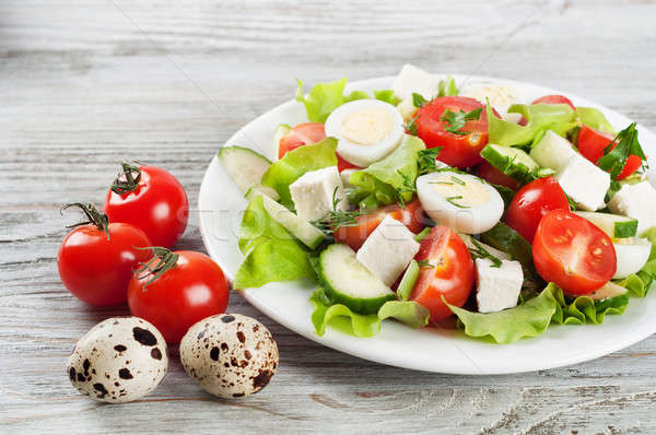 Salad with quail eggs and cherry tomato Stock photo © Artspace
